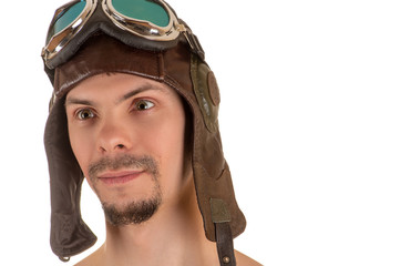 portrait of smiling man with mad look in flight flying helmet and goggles