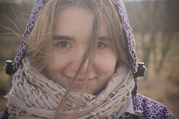 Beautiful girl smiling in winter field, face closeup