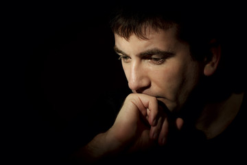 portrait of a pensive man on a dark background