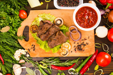 Cooked Pieces of Beef with Salsa and Seasonings