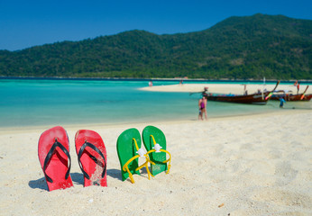 Colorful flipflop sandals on beach