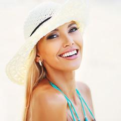 Beautiful smiling woman face closeup - perfect skin