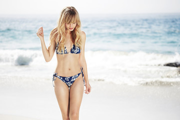 Wall Mural - Summer girl in bikini on beach