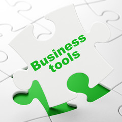 Finance concept: Business Tools on puzzle background