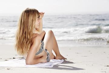 Wall Mural - Young beautiful woman relaxing on beach