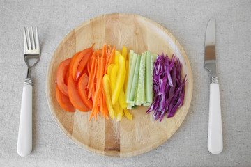 Go green, Rainbow salad on wooden plate
