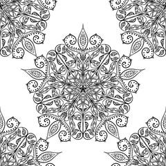 Handmade decorative ethnic seamless pattern. Classic mandala. Vector