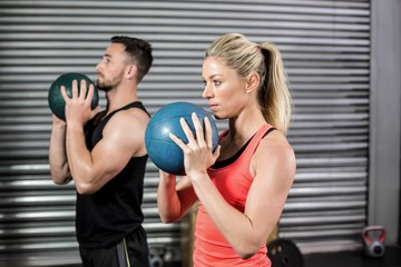 Couple doing ball exercise