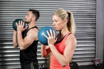 Couple doing ball exercise