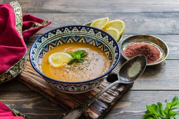 Lentil cream soup with lemon slices with mint