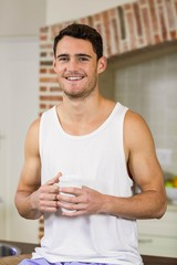 Portrait of young man holding a cup of tea