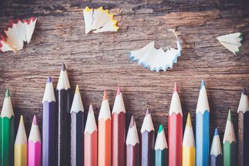 Color pencils on wooden background, vintage color tone