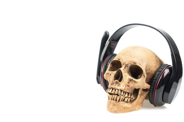 Human skull  in headphones isolated on a white background.