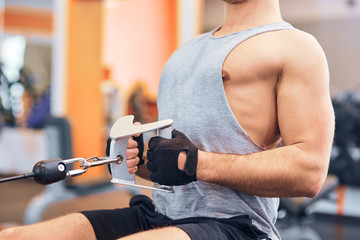 muscular body building men training his back at the gym