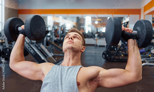 sport, bodybuilding, training and people concept - young man