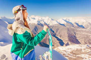 Snowboard. Sport woman in snowy mountains