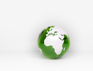 Green glass world globe - blank wall for text