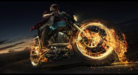 Man rides his motorcycle down the road. Flame and fire