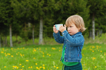 Little kid taking a selfie with cell phone