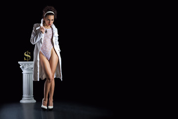 a girl in a white body and a white coat standing in the black background