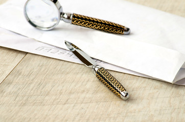 Stationery magnifying glass, paper knife and letter