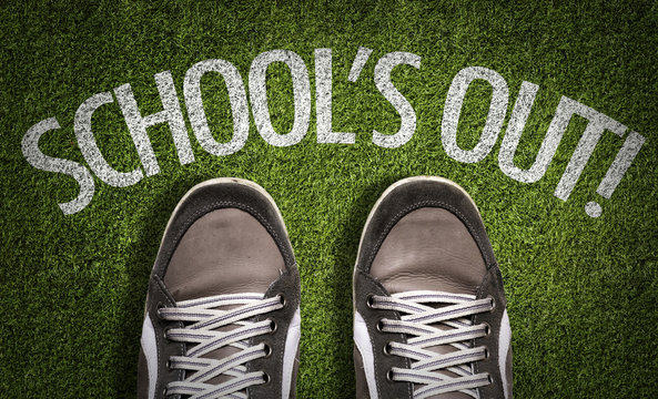 Top View of Sneakers on the grass with the text: Schools Out