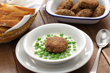 green peas fozelek (thich vegetable stew) and fasirt (fried meatball), hungarian cuisine