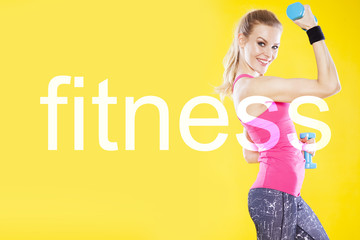 Happy fitness woman with dumbbells on isolated yellow background