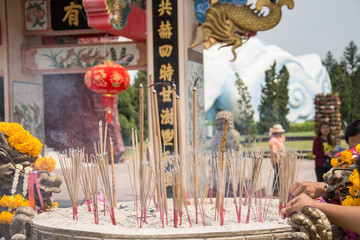 Joss sticks in to pot