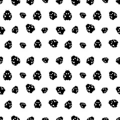 Seamless vector pattern with insects, chaotic background with decorative black and white ladybugs, on the white backdrop. Series of Animals and Insects Seamless Patterns.