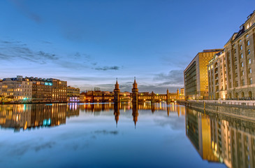 The River Spree with the Oberbaumbruecke in Berlin at dawn