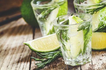 Drink with lime, rosemary, honey and soda, pitcher with crushed