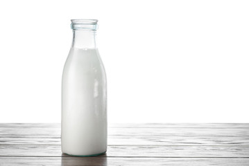 A bottle of milk on the table with isolated background
