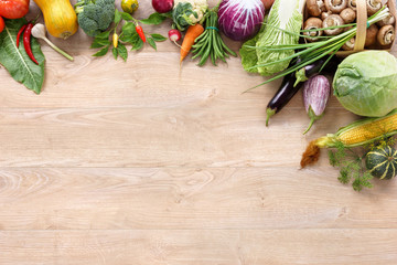 Healthy food on wooden table. Top view with copy space / high-res product, studio photography of different vegetables on old wooden table.