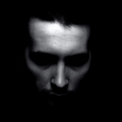 Portrait of unknown man in shadow. Black and white silhouette.