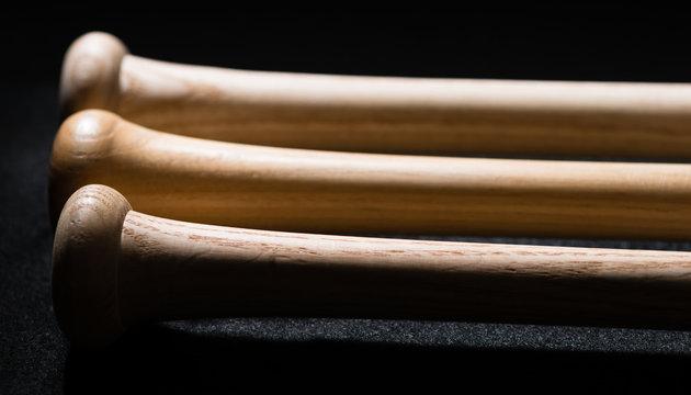Wooden baseball bats on black