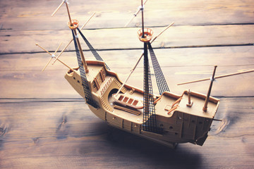 wooden ship on wooden table