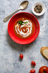 tomato cream soup in red bow, grunge background