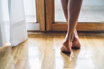 legs of a barefoot girl