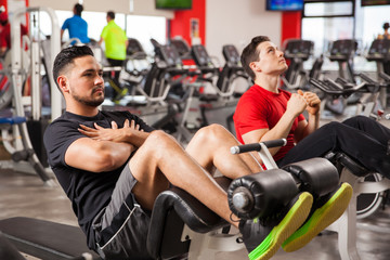 Men doing crunches in a gym