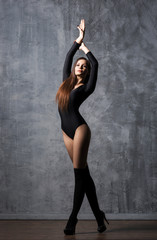 Young and beautiful fashion model is posing. Fit and sporty woman is dancing.