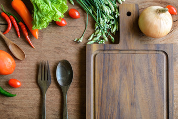 Fresh ingredients for cooking on wooden table background