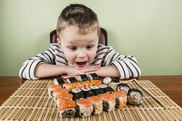 Boy eats a lot of sushi