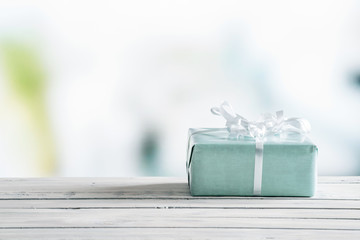 Blue gift box on a wooden table