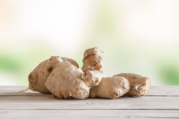 Raw ginger on a wooden table