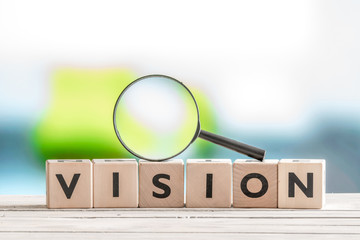 Vision word and a magnifying glass