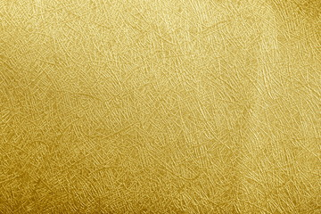 Golden paper foil on background texture.