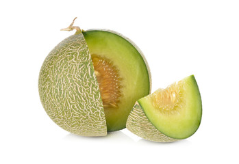 portion cut ripe honeydew melon on white background