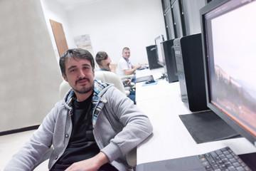 photo editor at his desk