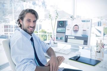 Composite image of nervous businessman peeking over desk